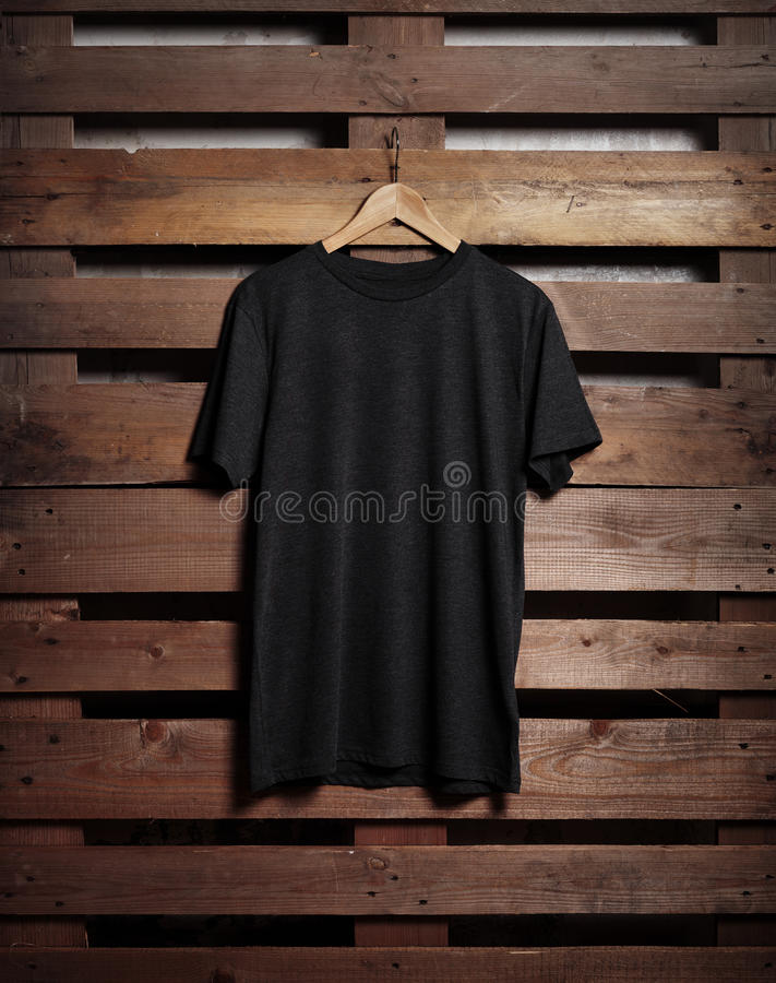 Free Photo Of Black Tshirt Holding On Wood Background Royalty Free Stock Image - 66012186