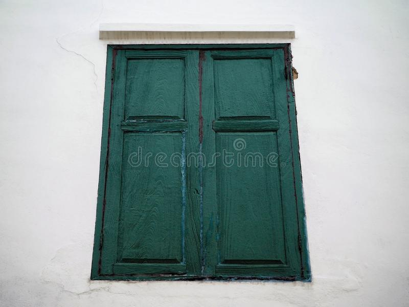 The Old Green Wooden Window and the White Wall royalty free stock photo