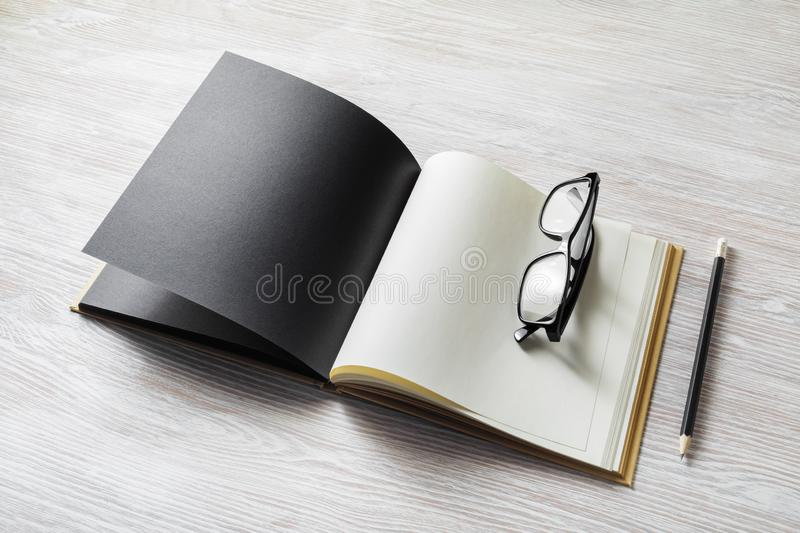 Book, glasses, pencil stock images