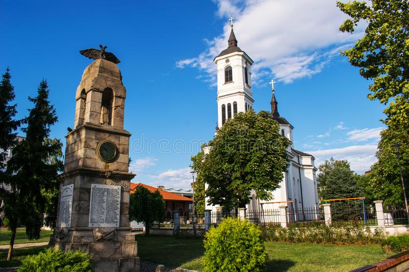 Photo with an Orthodox church and a historical monument located in Serbia, in the city of Kladovo. Travel on a summer day. A stock photos