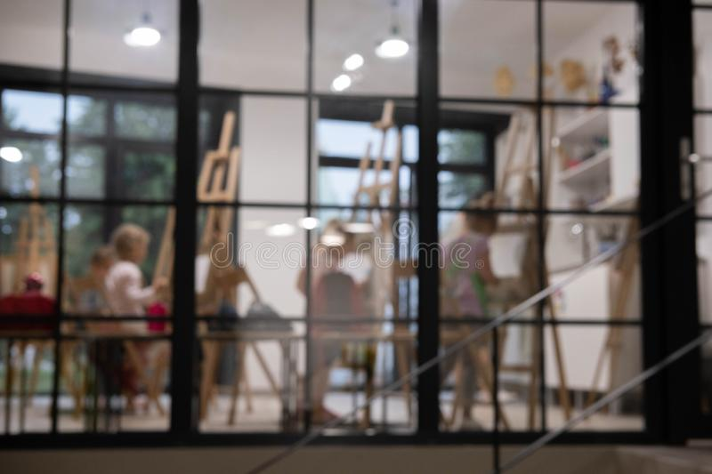 The photo is out of focus. Defocused drawing class background. Art classes defocused photo stock photography