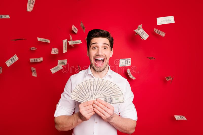 Photo of overjoyed nice good attractive handsome man having won lottery while isolated with red background. Photo of overjoyed nice good attractive, handsome man stock photo