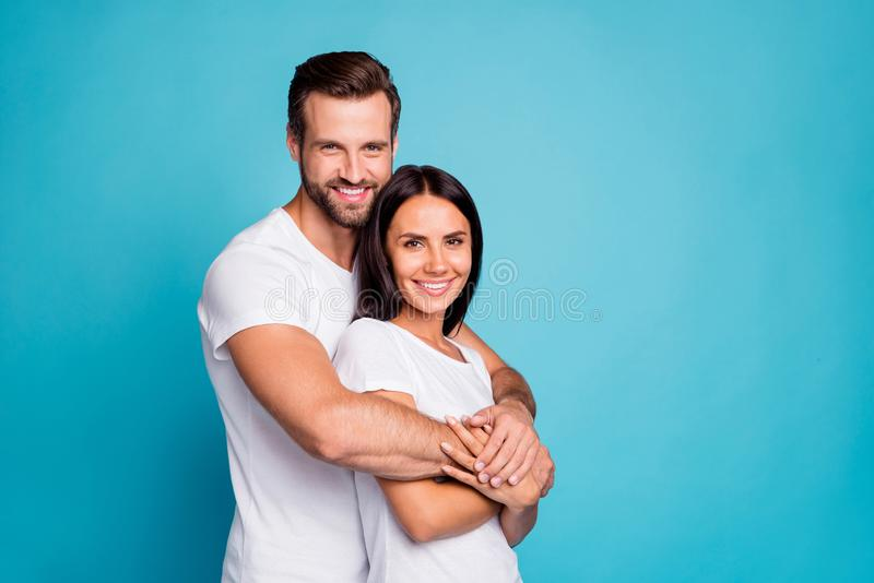 Photo of pair in love standing piggy back together wear casual outfit isolated blue background stock images