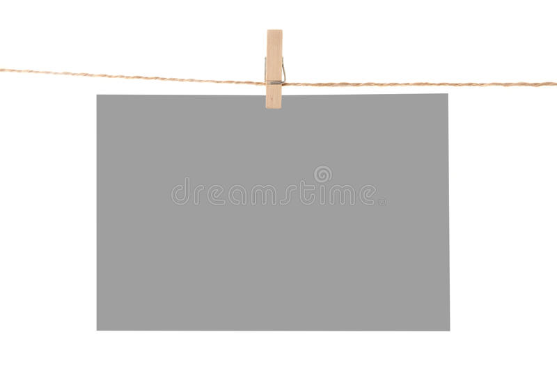 Photo paper attach to rope with clothes pins. Isolated on white background stock image