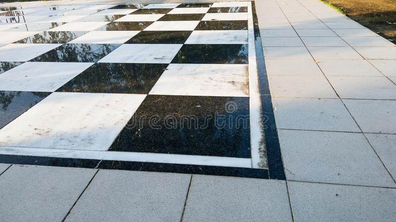 A Part of huge Chessboard in the central park. This is photo of A Part of huge Chessboard in the central park stock photos