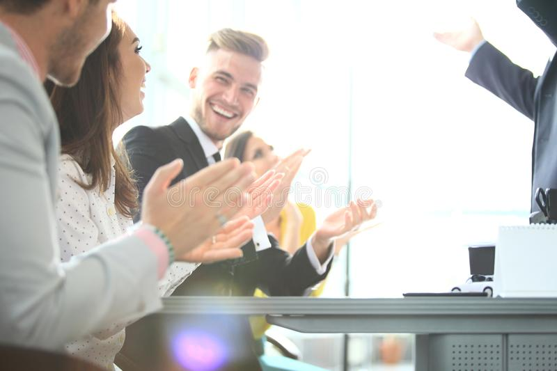 Photo of partners clapping hands after business seminar. Professional education, work meeting, presentation or coaching royalty free stock image
