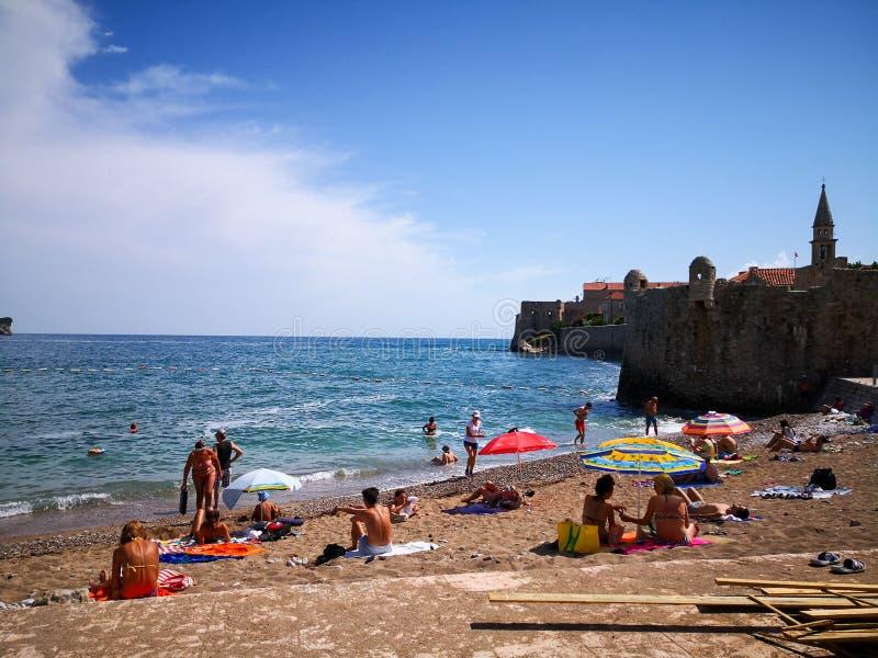 photo of people enjoying the budva beaches of montenegro stock images