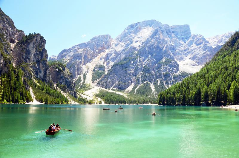 People having a rest time at the mountain lake in italian alps stock image