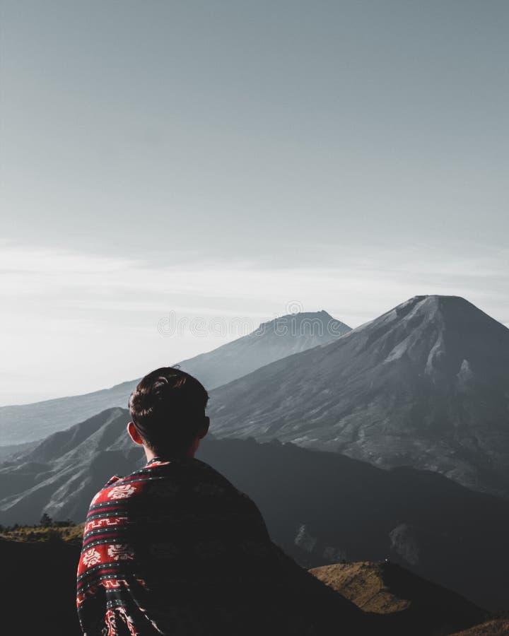 Photo of Person Atop Mountains royalty free stock photo