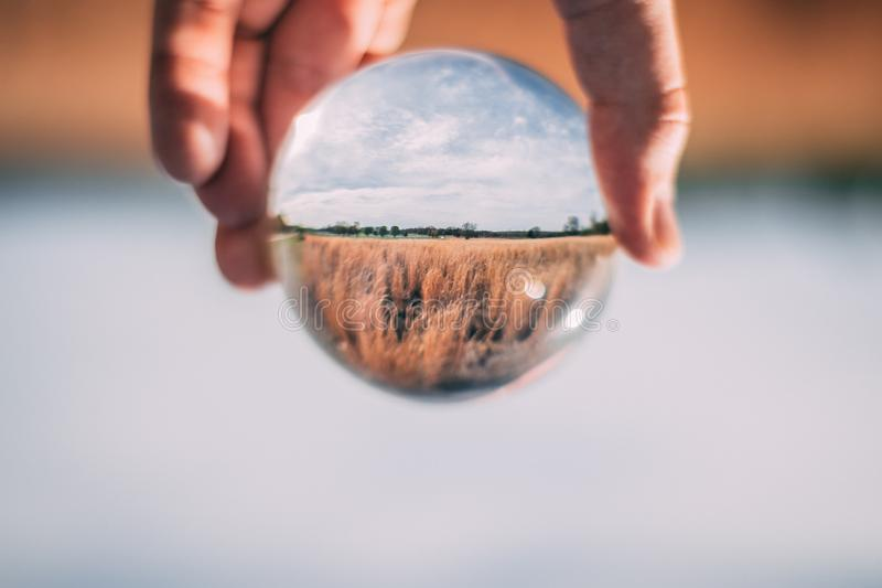 Photo of Person Holding Clear Glass Ball royalty free stock image