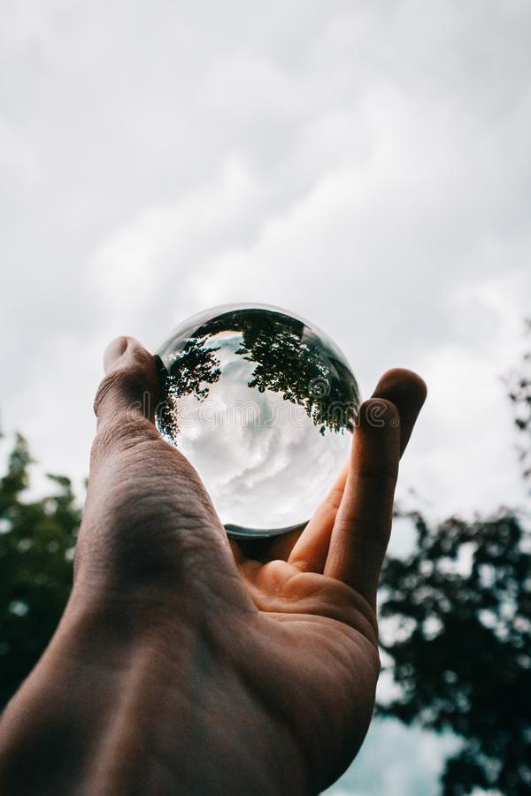 Photo of Person Holding Clear Glass Ball royalty free stock photo