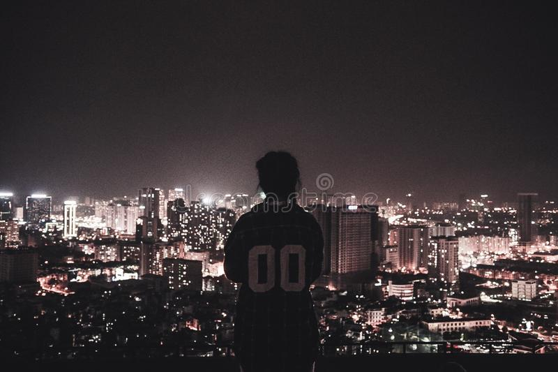 Photo of a Person Watching over City Lights during Night Time stock image