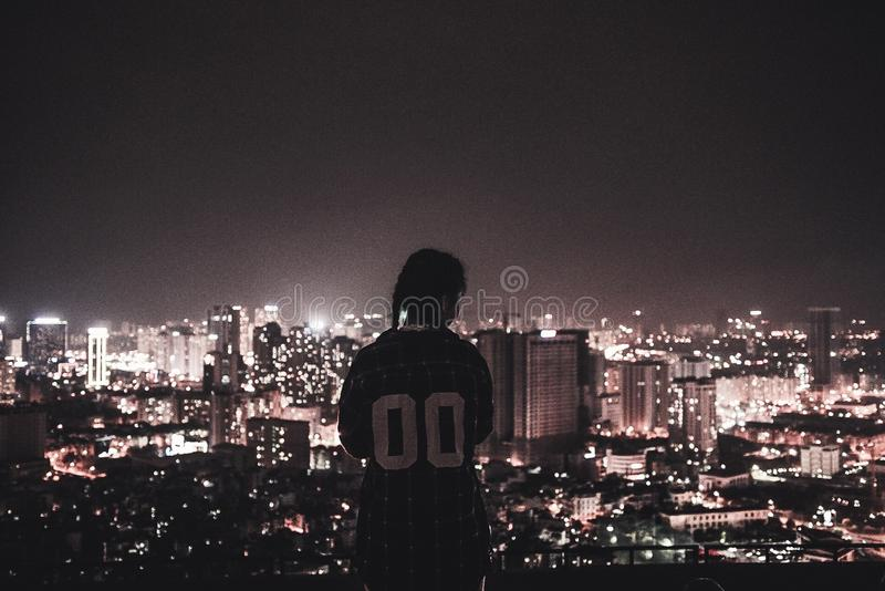 Photo of a Person Watching over City Lights during Night Time royalty free stock photography