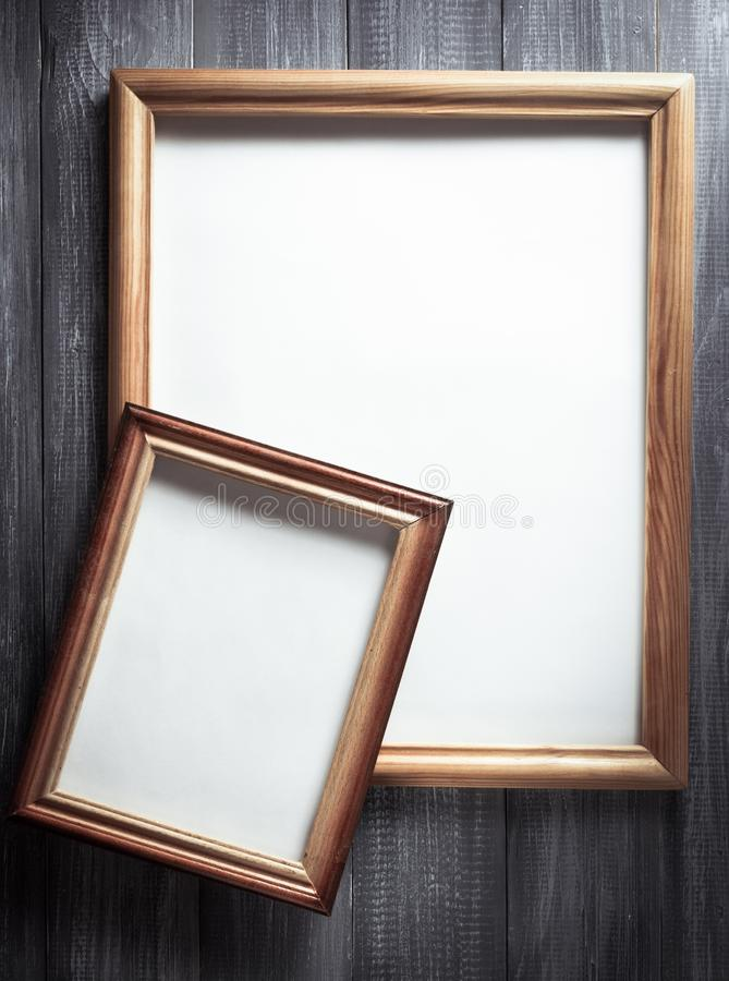 Photo picture frame on wood stock photos