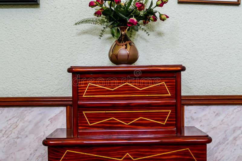 Photo Picture Image of wooden old vintage bedside table. Photo Picture Image of old vintage bedside table royalty free stock photo