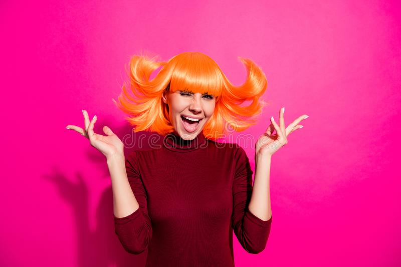 Photo of playful lady in bright wig throwing hair up air rejoicing about weekend time wear red turtleneck isolated pink. Photo of playful lady in bright wig stock photos