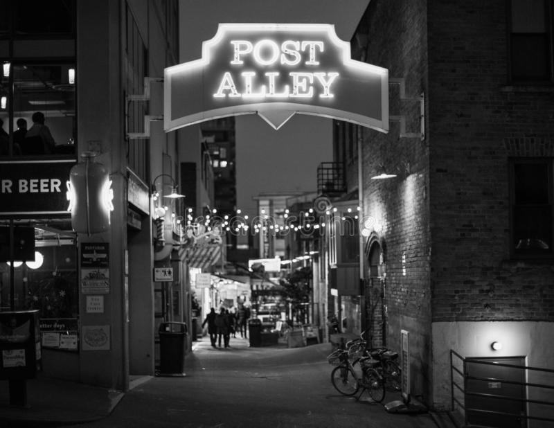 Post Alley in Seattle Black and White. A photo of the popular tourist alley called Post Alley near Pike Place Market in Seattle, Washington. I chose to convert stock image