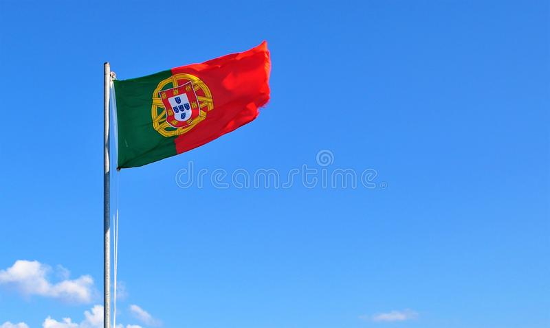 The portuguese flag in the wind at Juromenha stock photography