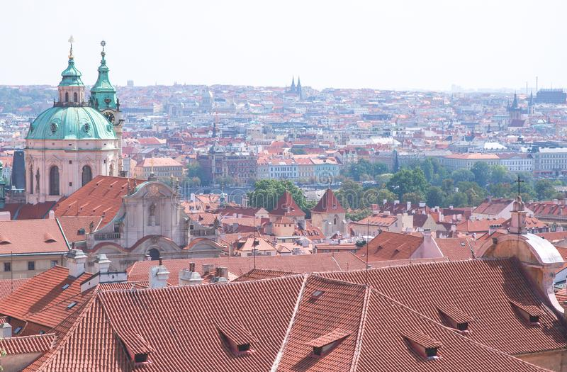 Photo of Prague, Czech Republic for long-focus lens. The red roofs of the tile on the old town architecture royalty free stock photo