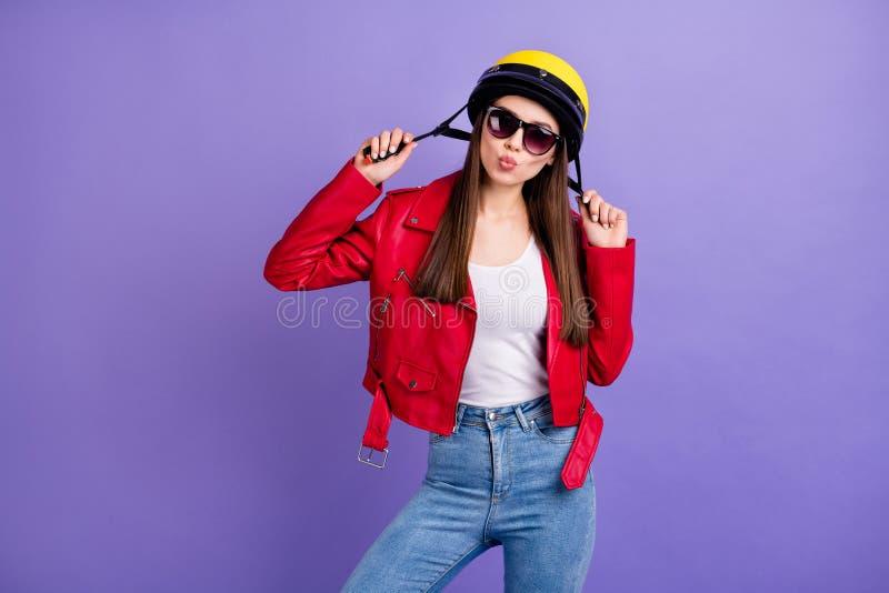 Photo of pretty flirty lady motorcyclist bike tour send air kisses wear stylish yellow helmet red leather jacket sun. Photo of pretty flirty lady motorcyclist royalty free stock photography