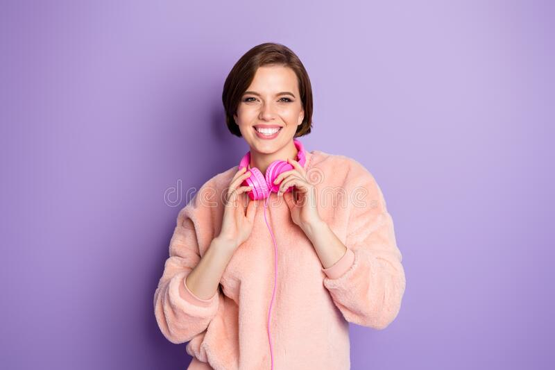 Photo of pretty funny amazing millennial lady cool earphones listening music youth song rejoicing wear casual pink. Photo of pretty funny amazing millennial lady stock images