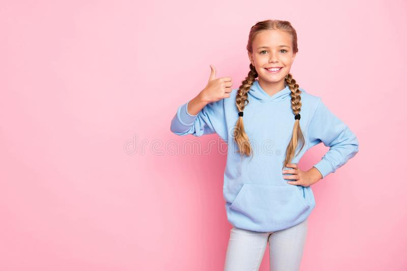 Photo of pretty little lady raising thumb up advertising buy cool school supplies wear casual blue hoodie pullover royalty free stock images