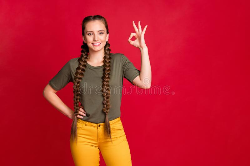 Photo of pretty teen model lady showing okey symbol expressing agreement good quality wear casual t-shirt yellow stock photo