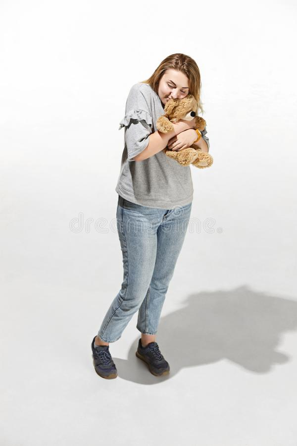 Photo of pretty woman hug cute soft toy, closeup portrait of pretty female with teddy bear royalty free stock images