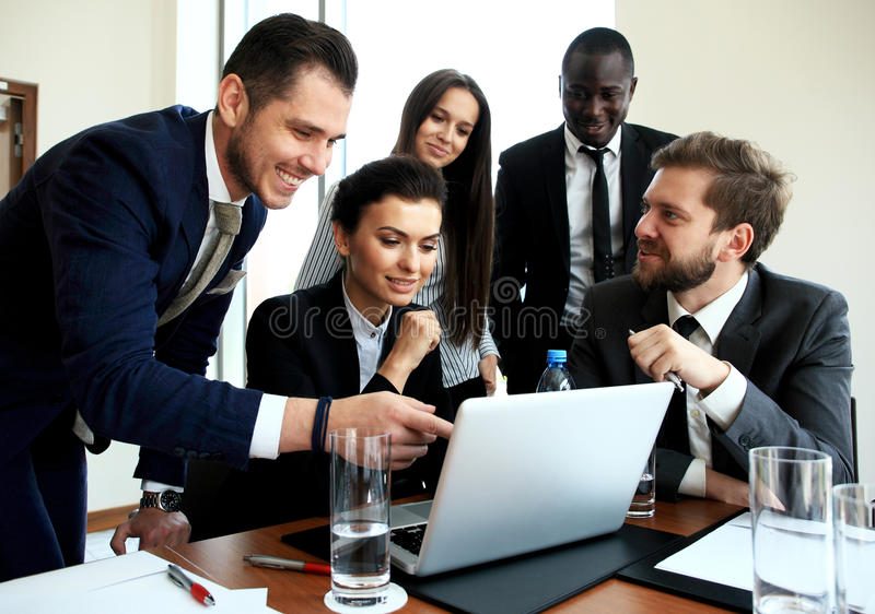 Photo professional crew working with new startup project. Project managers meeting. Analyze business plans laptop. stock photo
