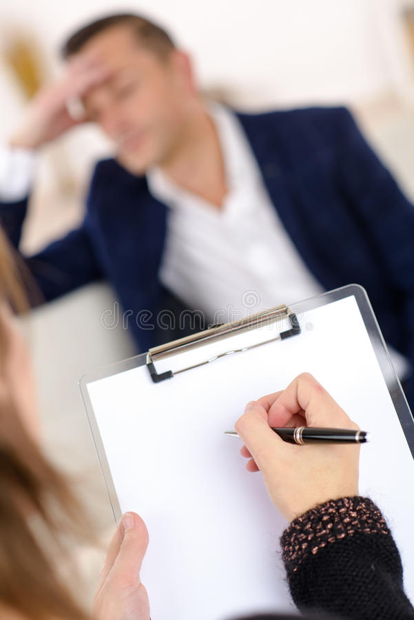 Photo professional female counselor helping depressed man. Photo of professional female counselor helping depressed man stock photo
