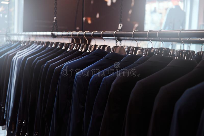 Photo of a rack with suit jackets in a menswear store. Photo of a rack with suit jackets in menswear store royalty free stock photography