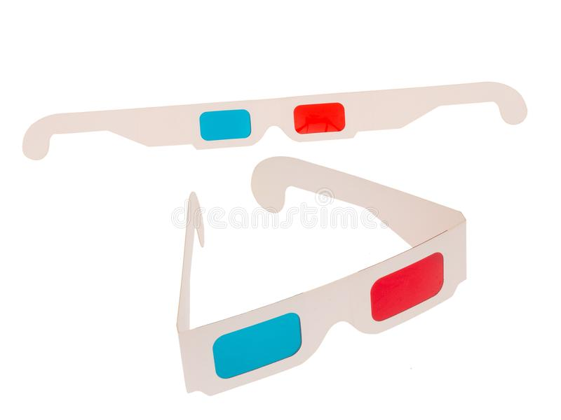 Photo of red and cyan cardboard 3D glasses isolated on white. Two pairs. Folded and flat. royalty free stock photos