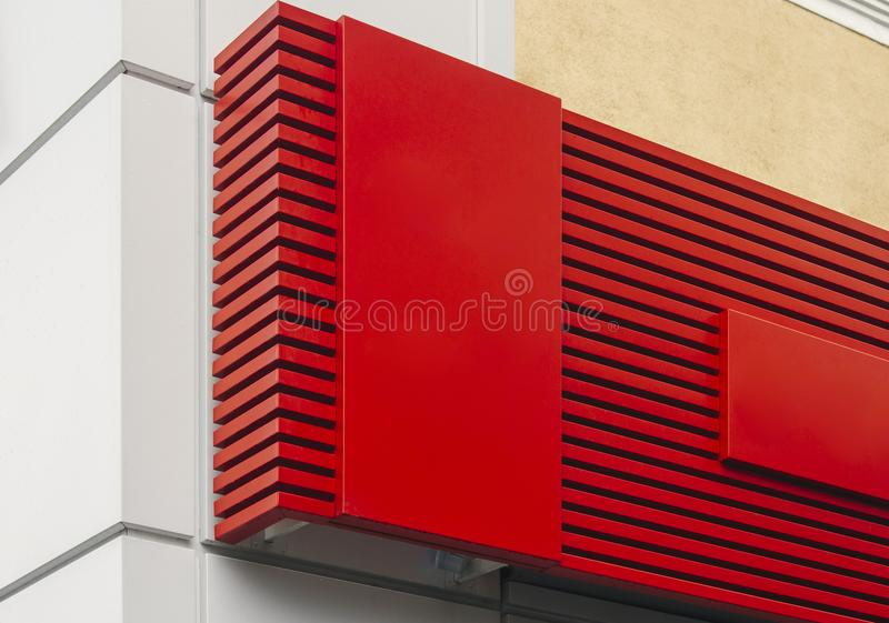 Photo of red empty signboard on wall background. stock photography