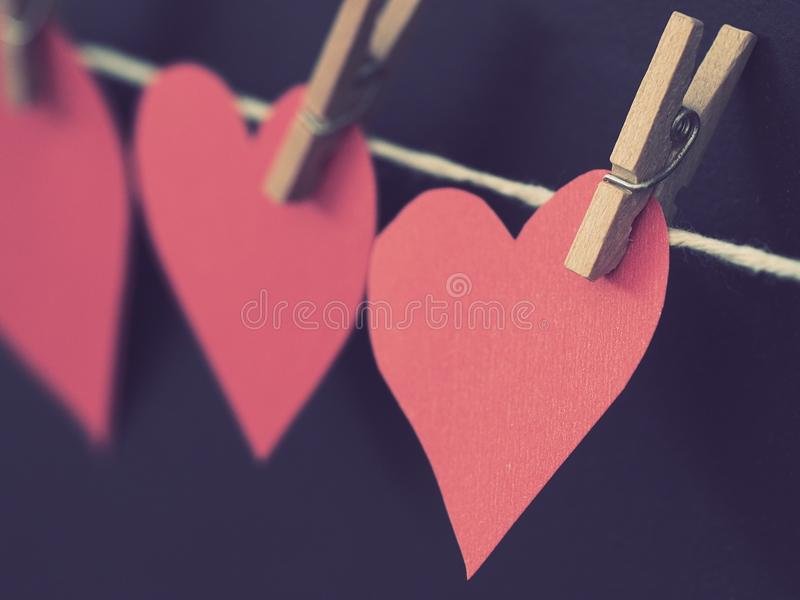 Photo of Red Heart-shaped Paper Hanging on Rope stock images