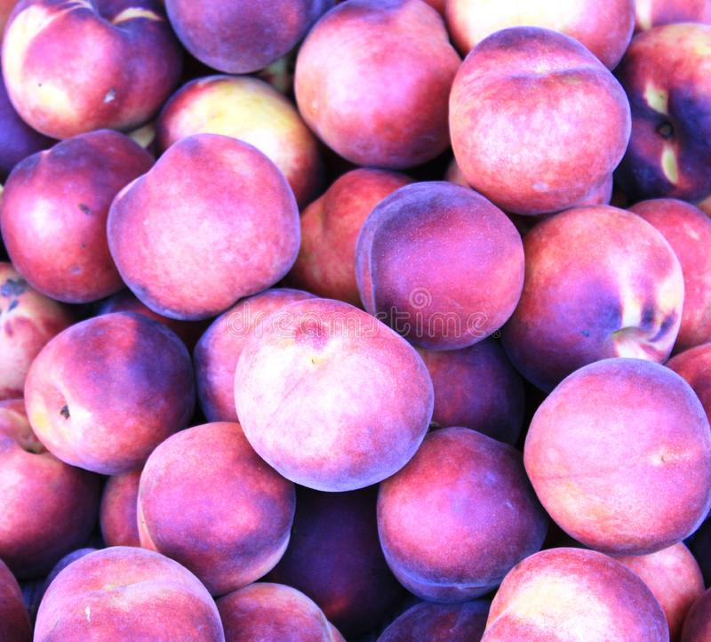 Peaches in the shop in Bulgaria. Photo of red and yellow peaches. Delicious fruit full of vitamines. Organic and yummy , good as snack or addition to breakfest royalty free stock photos