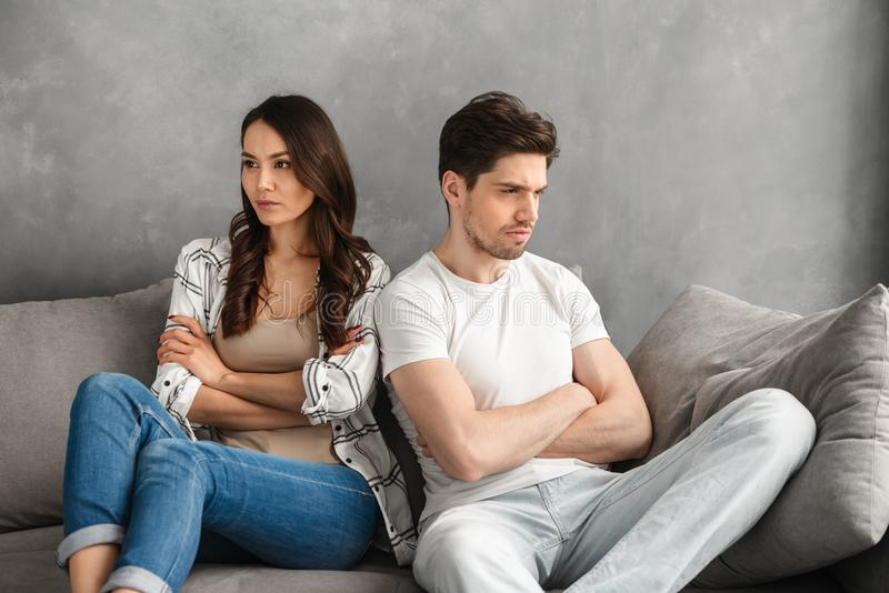 Photo of resentful guy and girl acting like arguing couple and n stock photography