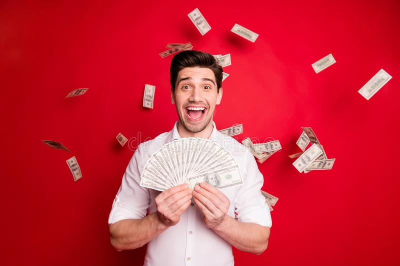 Photo of rich trendy wealthy man having received his salary while isolated with red background. Photo of rich trendy wealthy, man having received his salary stock photography