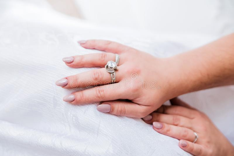 Ring on the hand of the bride. Close-up royalty free stock image