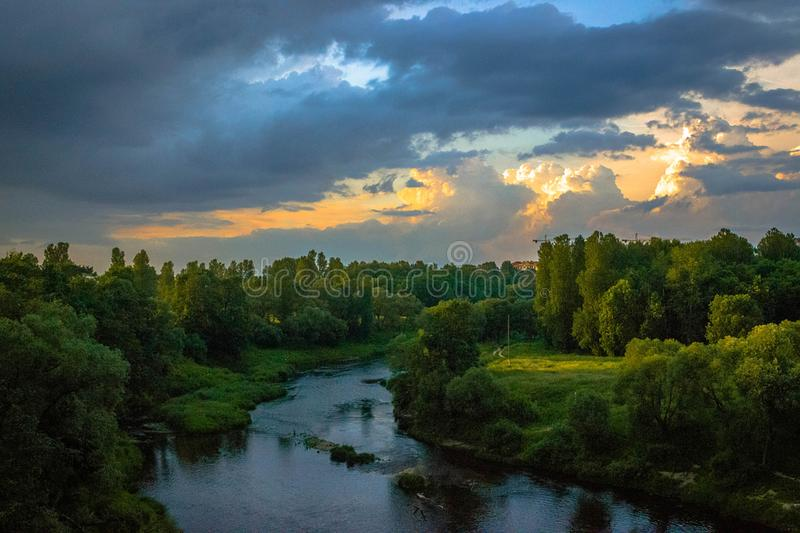 Photo of River Between Green Grass Fields royalty free stock image