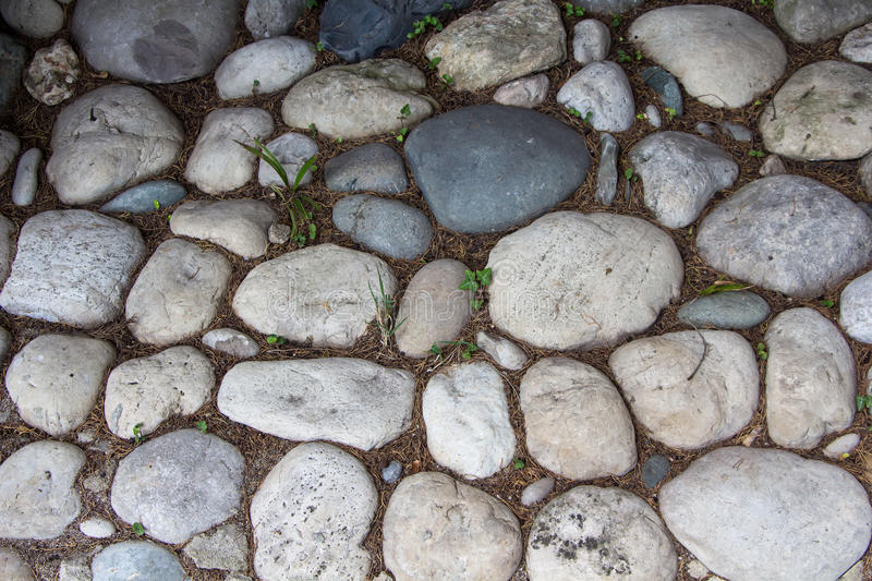 Photo of the road exactly paved with stones. Summer stock photos