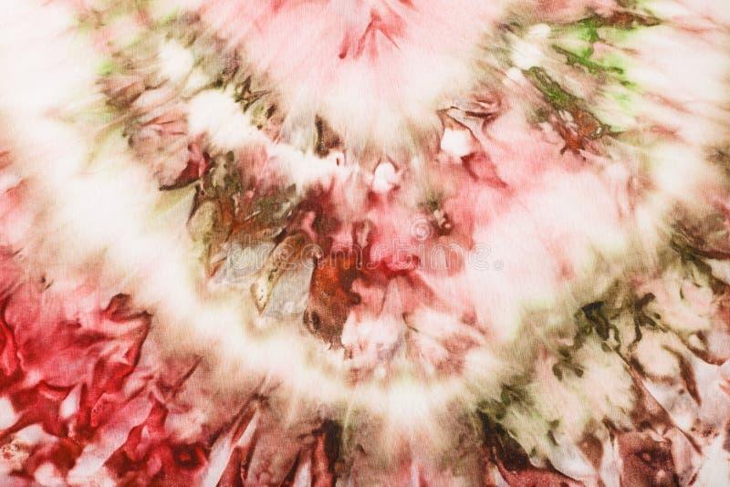 Photo rose et verte abstraite sur le batik en soie photographie stock libre de droits