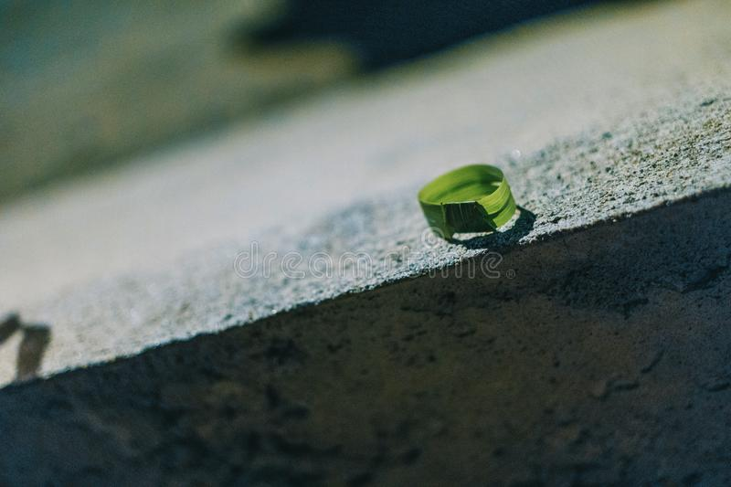 Photo of Round Green Leaf on Gray Concrete Bench royalty free stock photos
