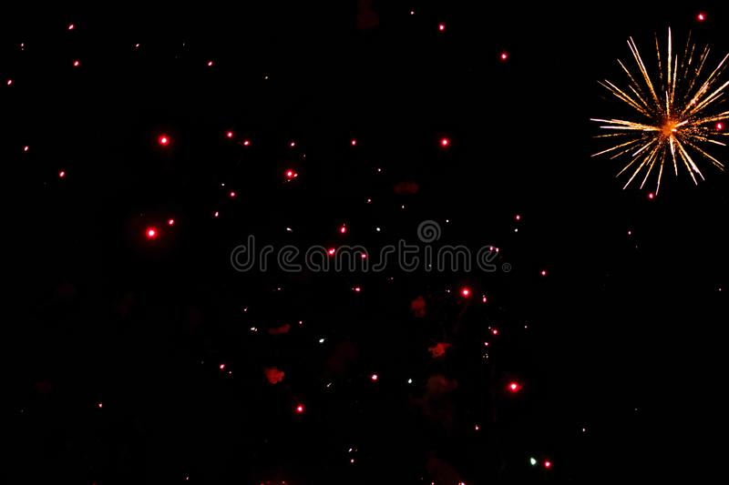 A photo of a salute in the night sky. Bright texture of festive fireworks. Abstract holiday background with various colors firewor. Ks light. New Year`s stock image