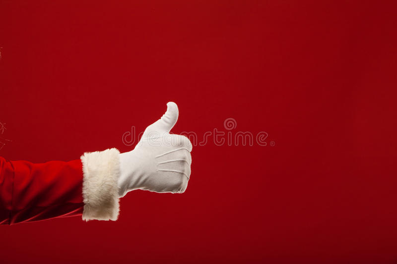 Photo of Santa Claus gloved hand in pointing royalty free stock photography