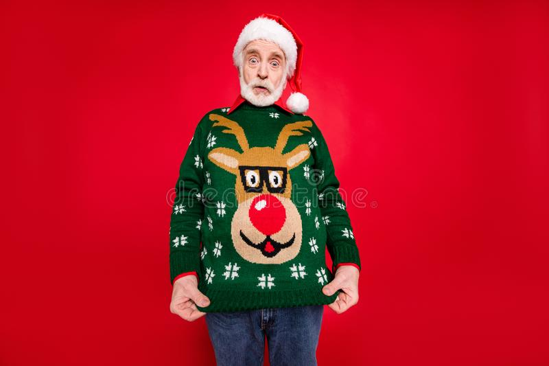 Photo of santa granddad showing ugly deer ornament pullover dressed on himself not understand idea of costume theme x stock images