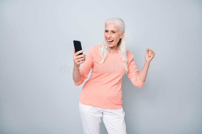 Photo of satisfied cool granny following trends sharing hot posts on social networks isolated grey background. Photo of satisfied cool granny following trends stock images