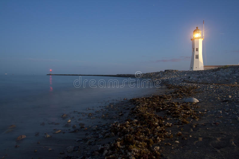 Photo of a Scituate Lighthouse in New England. At night royalty free stock images