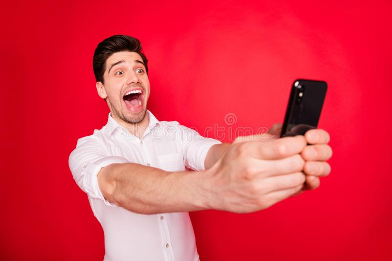 Photo of screaming laughing man taking selfie with pleasure while isolated with red background. Photo of screaming laughing, man taking selfie with pleasure royalty free stock photos