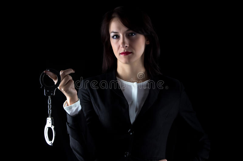 Photo serious business woman withpair of handcuffs stock photo