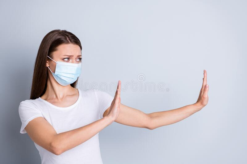 Photo of serious lady keep social distance avoid afraid of people contact raise arms side empty space stay away from me royalty free stock photography